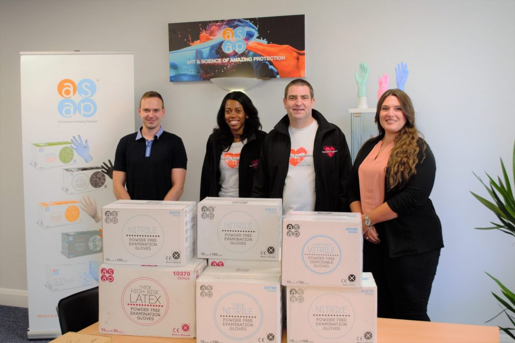 The Lewis Foundation visiting ASAP Innovations UK at their office to collect their donation